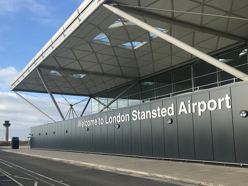 Welcome to London Stansted Airport sign outside terminal building