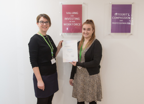 Gemma Manning, HR Director (left) congratulates Ginette Northmore, Education Receptionist (right)