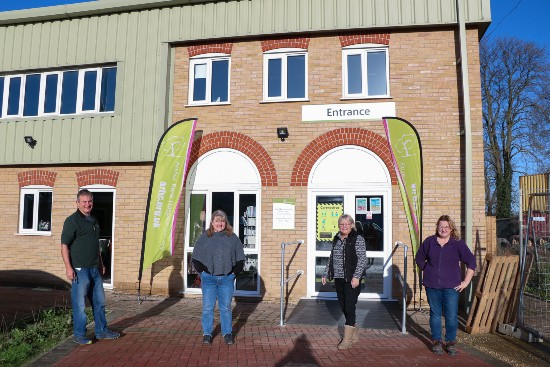 Colleagues and volunteers from Arthur Rank Hospice Charity's Retail Hub team outside the building on the Eastern Leather Industrial Estate between Sawston and Pampisford. The Grand Reopening will take place in the car park on Saturday 10 July.