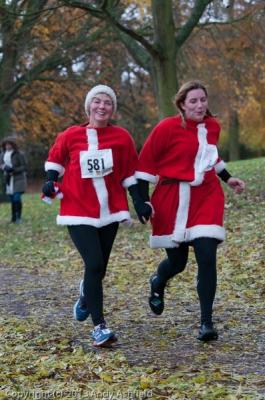 Women in red santa outfits running at the Arthur Rank Hospice Charity Festive 5K