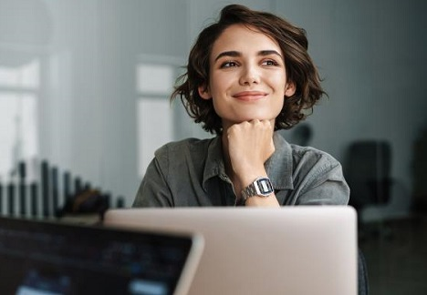 Smiling woman sitting at a computer