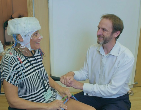 Cambridge-based clinician and researcher, Professor James Rowe, with a patient