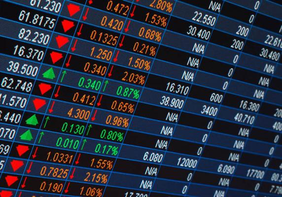 stock market listings on a screen