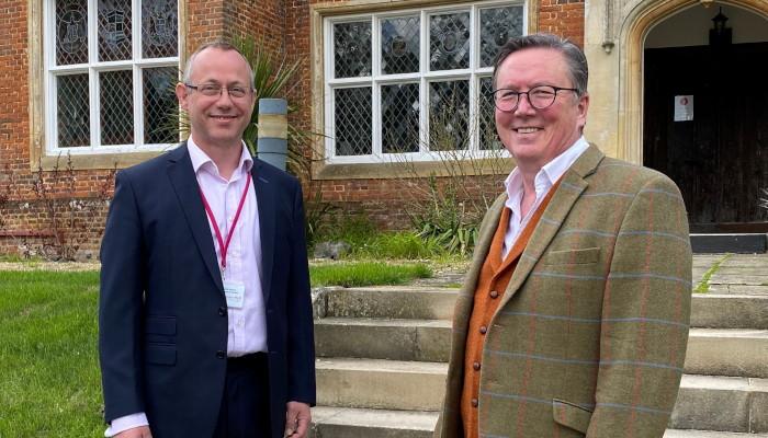 John Arthur (left) with Mike Macnamee outside Bourn Hall