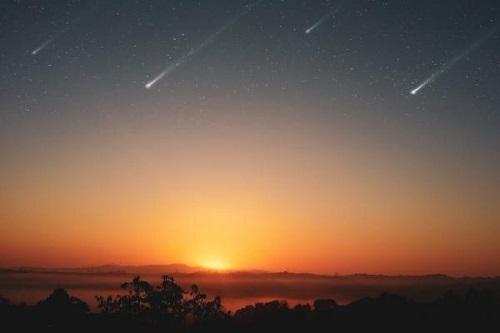 shooting stars in a night sky