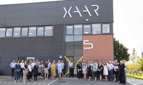 Xaar team outside the new HQ building