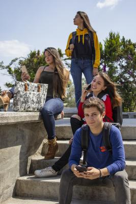 Group of younf people sitting on stairs
