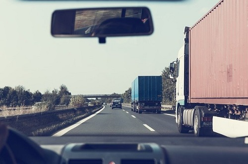 Trucks on the highway -- Image by Markus Spiske from Pixabay