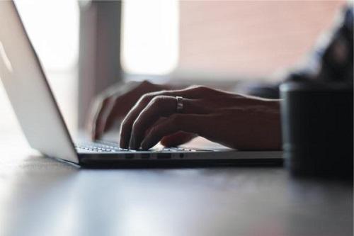 hands - using a laptop computer
