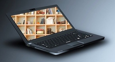 Laptop with image of library on screen   - Image by kalhh from Pixabay