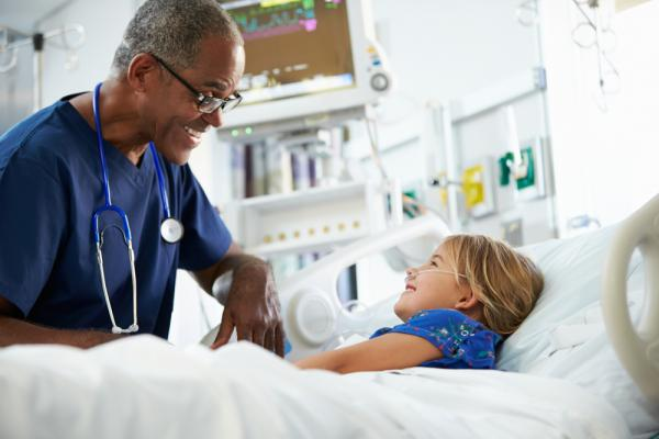 Male nurse with young patient
