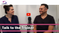 A photo of two people talking about training