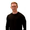 Matt Ferguson smiles at camera and wears a black top