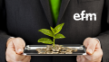 efm man holding tray with coins underneath small green plant