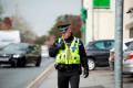 A UK police officer with a Sepura SC20 TETRA radio.