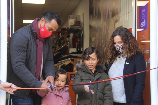 Keely Blows and Curtis Irish, son Teddy, nine, and daughter Marlowe, cutting a ribbon to mark both the grand opening of EACH's Royston shop and reopening of its 42 other shops across Cambridgeshire, Essex, Norfolk and Suffolk.