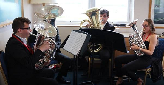 Amy Ewen (right), with band members of 'When Tuba Come One'.